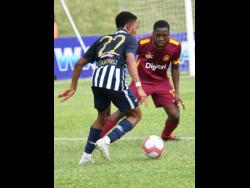 Nickari Campbell (left) of Jamaica College tries to get by Christopher Matthews of Wolmer's Boys School in a ISSA/Digicel Manning Cup game at Stadium East on Monday, September 16, 2019.