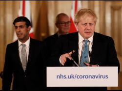 Britain's Chancellor Rishi Sunak, British Prime Minister Boris Johnson, and Chief Scientific Officer Patrick Vallance arrive for a press briefing on the ongoing situation with the COVID-19 coronavirus outbreak, at 10 Downing Street in London, yesterday.