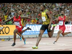 Usain Bolt, right, wins the gold medal in the men's 100m ahead of United States' Justin Gatlin, left, at the World Athletics Championships at the Bird's Nest stadium in Beijing.