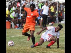 Tivoli Gardens captain Kemar Flemmings (left) evades a tackle from Nacquain Brown of UWI during a Red Stripe Premier League match at the Edward Seaga Sports Complex on Sunday, January 19, 2020.