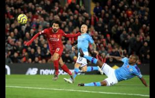 Liverpool's Mohamed Salah (left) scores his side's second goal of the game during the English Premier League match at Anfield, Liverpool, England, on November 10, 2019.