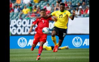 Jamaica's Damion Lowe (right) and Panama's Gabriel Torres battle for the ball during the first half of a Concacaf Gold Cup match in Philadelphia last year.